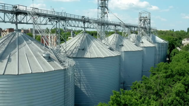 flying over silo storage - weights stock videos & royalty-free footage