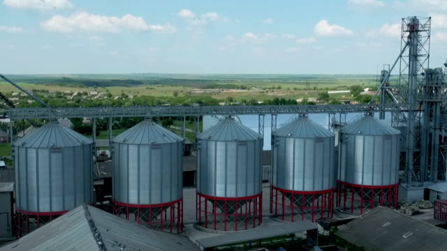 flying over silo storage - mass unit of measurement stock videos and b-roll footage