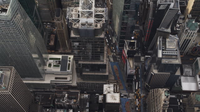 Flying over skyscrapers near Times Square and Rockefeller Center. Shot in 2011.