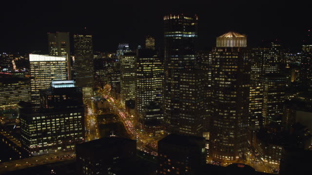 flying over skyscrapers of downtown boston at night. shot in 2011. - artbeats stock-videos und b-roll-filmmaterial