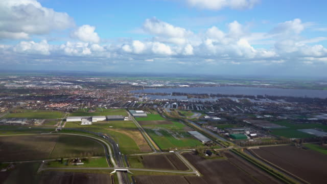 flying over suburbs of amsterdam - netherlands stock videos & royalty-free footage