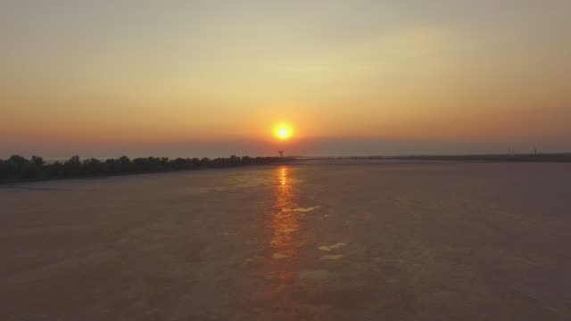 flying over surface of salt lakes on sunset, aerial video - backwater stock videos & royalty-free footage