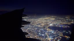 Flying over the city by night