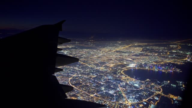 flying over the city by night - aircraft wing stock videos & royalty-free footage