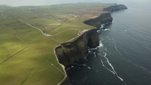 flying over the cliffs of moher, county clare, ireland. - coastline stock videos & royalty-free footage
