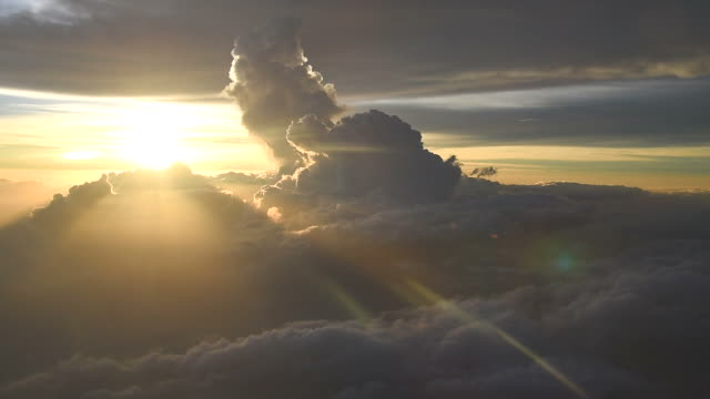 flying over the clouds - horizon over water stock videos & royalty-free footage