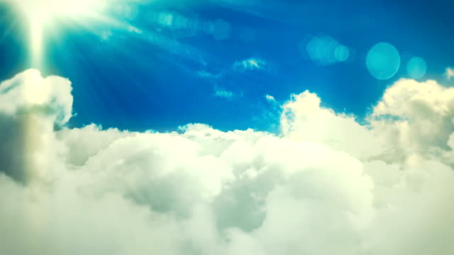 flying over the clouds with sun and lensflares loopable cloudscape background animation - buddhism stock videos & royalty-free footage