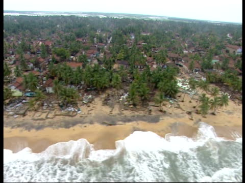 flying over the coast of sri lanka following the 2004 indian ocean tsunami - 2004 stock-videos und b-roll-filmmaterial