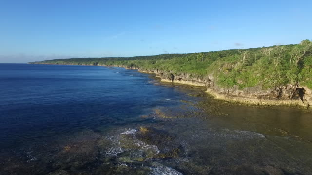 flying over the coastline of niue - samoa stock videos & royalty-free footage