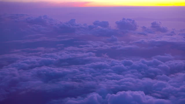 flying over the colorful sky on sunset flight with beautiful cloud - purple stock videos & royalty-free footage