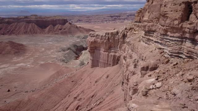 flying over the desert landscape near goblin valley - sandy utah stock videos and b-roll footage