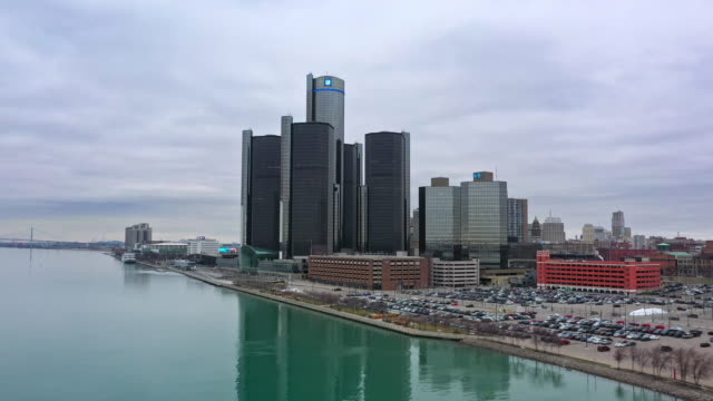 flying over the detroit river looking towards downtown - detroit river stock-videos und b-roll-filmmaterial