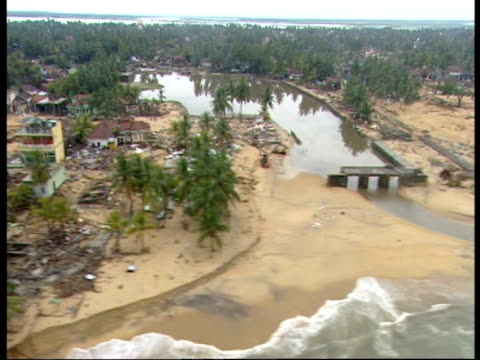 stockvideo's en b-roll-footage met flying over the devastated sri lankan coastline following the 2004 tsunami. - 2004