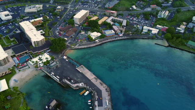 flying over the famous hawaiian kailua-kona bay waterfront, usa - big island hawaii islands stock videos & royalty-free footage