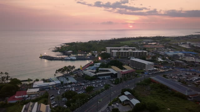 flying over the famous hawaiian kailua-kona city and bay during sunset, usa - big island hawaii islands stock videos & royalty-free footage