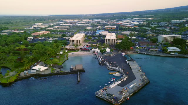 flying over the famous hawaiian kailua-kona city bay, usa - big island hawaii islands stock videos & royalty-free footage
