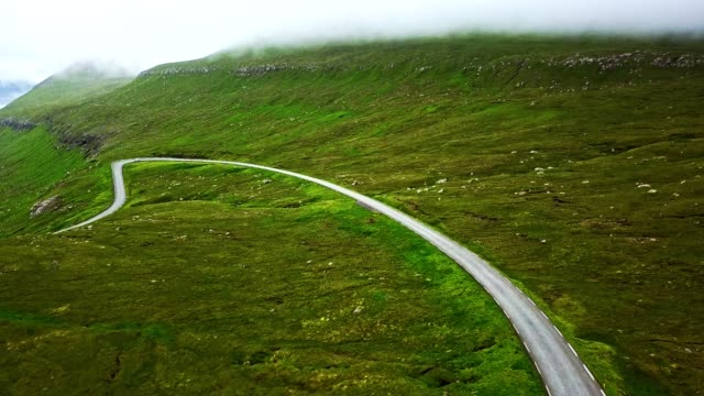 flying over the faroean roads - faroe island - dramatic landscape stock videos & royalty-free footage