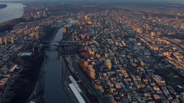 Flying over the Harlem River between the Bronx and Washington Heights in New York City.