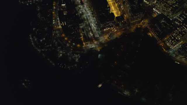 Flying over the Hudson at night to look down at Financial District in Lower Manhattan. Shot in 2011.