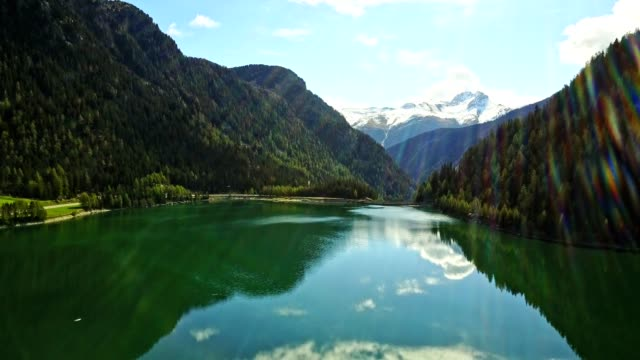flying over the lake in switzerland - wide stock videos & royalty-free footage