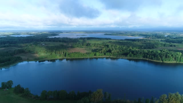 flying over the lakes. aerial drone shot. - belarus stock videos & royalty-free footage