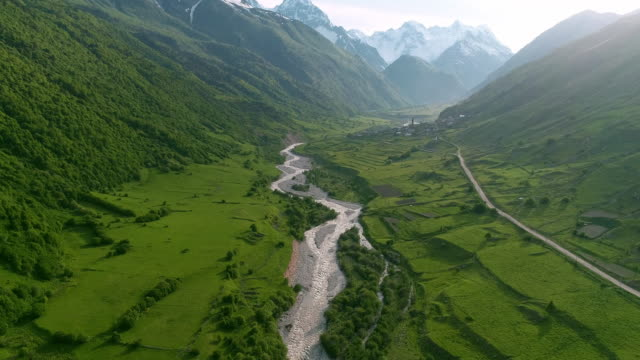 flying over the mountain gorge. the road along the river, in the valley - mountain range stock videos & royalty-free footage