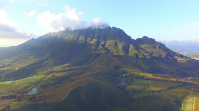 flying over the mountains - stellenbosch stock videos and b-roll footage