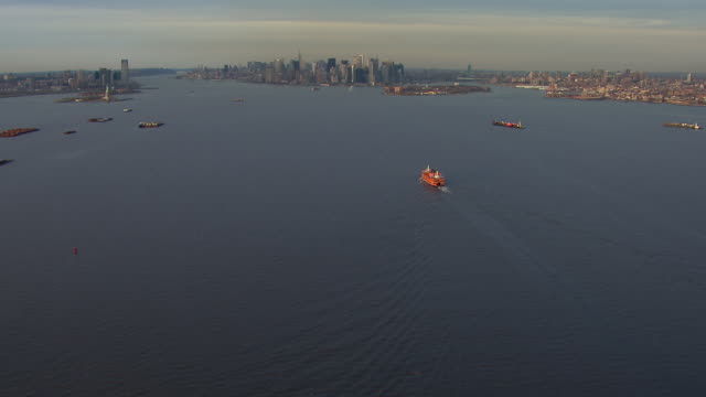 flying over the new york harbor toward the island of manhattan in new york city. - new york harbor stock videos & royalty-free footage