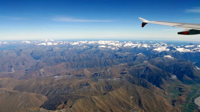 flying over the new zealand south island mountains - queenstown stock videos & royalty-free footage