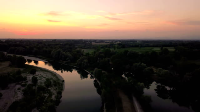Flying over the river at sunset