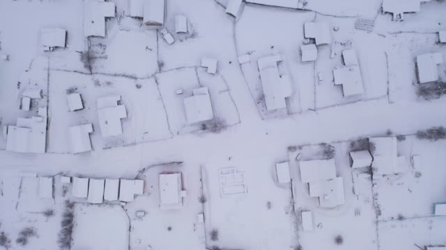 flying over the village in winter season - deep snow stock videos & royalty-free footage