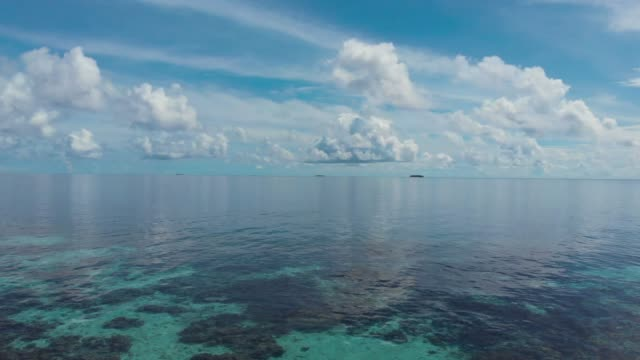 flying over the water in the maldives - seascape stock videos & royalty-free footage