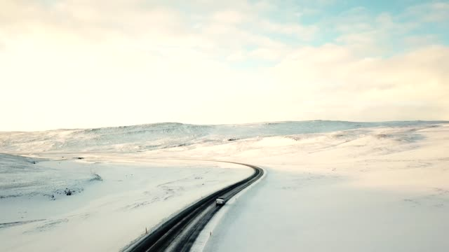flying over the winding road in iceland at dusk - infinity stock videos & royalty-free footage