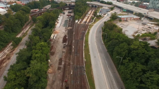 Flying over train tracks to city, Baltimore, Maryland, United States
