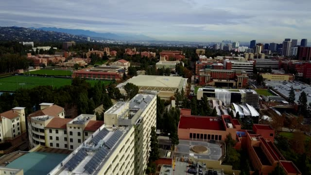 flying over ucla and westwood - westwood neighborhood los angeles stock videos & royalty-free footage