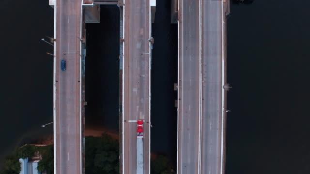 flying over urban bridge, baltimore, maryland, united states - hafen von baltimore stock-videos und b-roll-filmmaterial