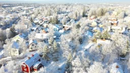 Flying over villa area, winter day