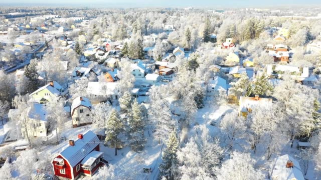 flying over villa area, winter day - svezia video stock e b–roll