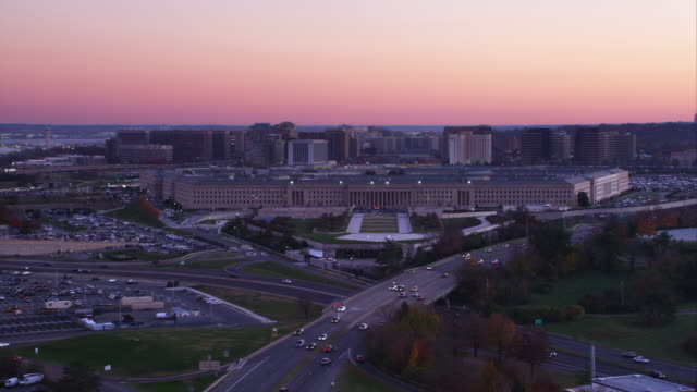 flying over washington boulevard toward the pentagon at dusk; arlington cemetery on right, pentagon city in background. shot in 2011. - the pentagon stock videos & royalty-free footage