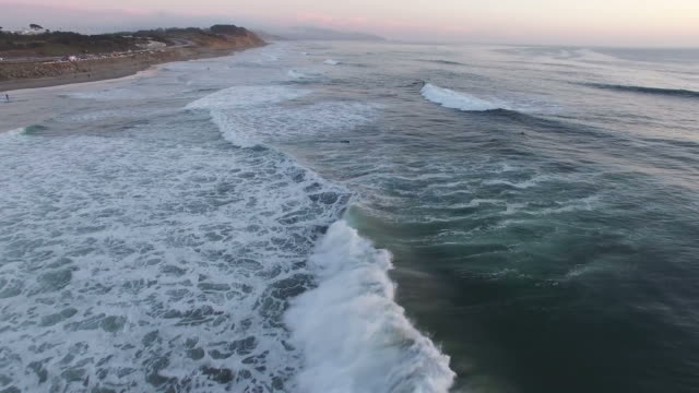 flying over waves at sunset - santa barbara california stock videos & royalty-free footage