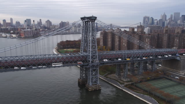 flying over williamsburg bridge, looking back toward projects. shot in 2011. - williamsburg bridge stock videos & royalty-free footage