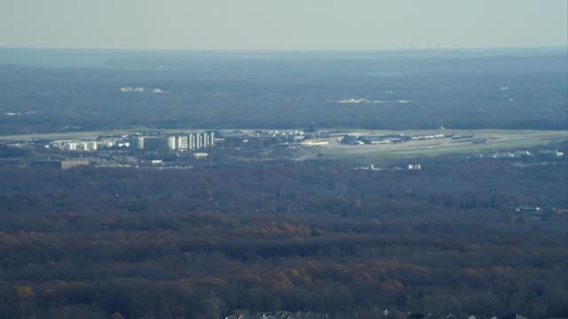 stockvideo's en b-roll-footage met flying over woodland past baltimore airport. shot in november 2011. - artbeats