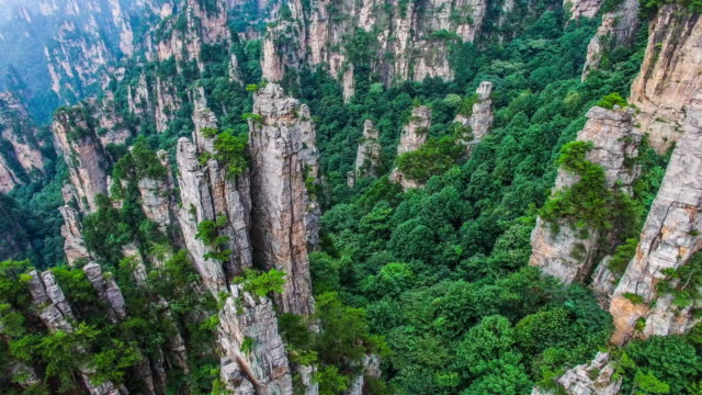 flying over zhangjiajie national park in china - national forest stock videos and b-roll footage