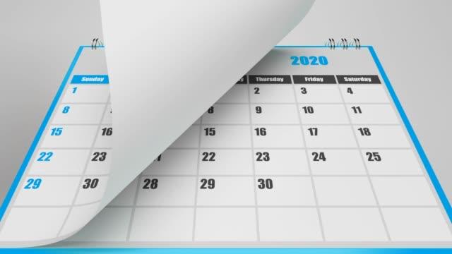 fliegende seiten des blauen kalenders 2020 jahr - kalender stock-videos und b-roll-filmmaterial