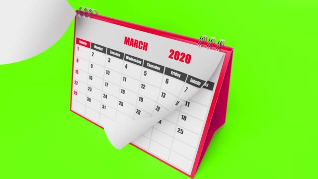 flying pages of calendar 2020 year on green background - week stock videos & royalty-free footage