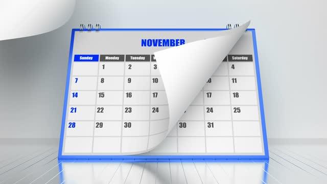vídeos y material grabado en eventos de stock de páginas voladoras del calendario 2021 con marco azul sobre fondo blanco - calendario