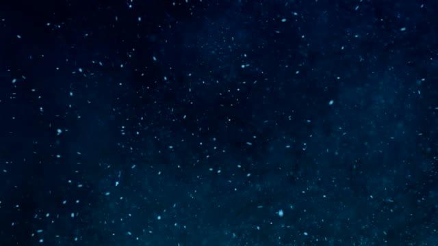 vídeos y material grabado en eventos de stock de flying partículas - fondo turquesa