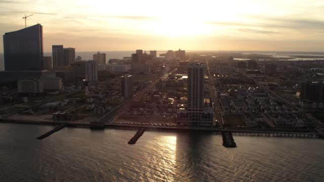 vídeos de stock, filmes e b-roll de flying past atlantic city, new jersey, looking back at casino resorts. shot in november 2011. - atlantic city