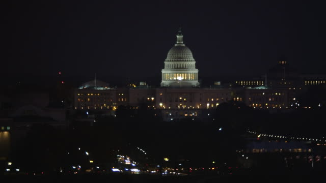 flying past capitol dome and national mall toward constitution avenue at night. shot in 2011. - artbeats stock videos & royalty-free footage