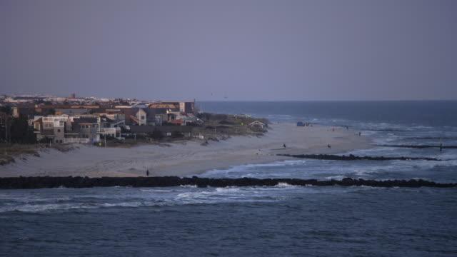 flying past city of beach haven on long beach island, new jersey at dusk. shot in november 2011. - artbeats bildbanksvideor och videomaterial från bakom kulisserna